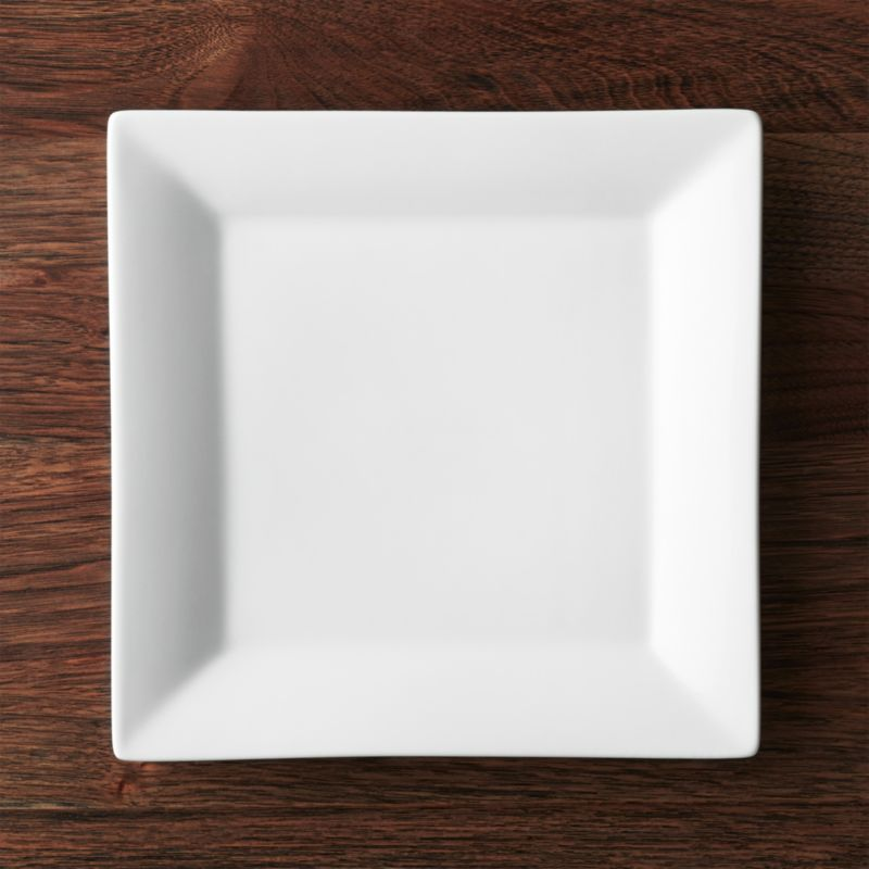 Clean square of white porcelain features broad flared rim for all-purpose serving. Chip-resistant plate goes from microwave or oven to table and dishwasher.<br /><br /><NEWTAG/><ul><li>Porcelain</li><li>Dishwasher-, microwave- and oven-safe</li><li>Made in China</li></ul>
