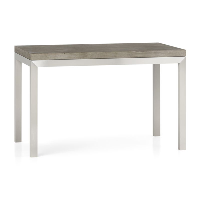 "You've designed your ideal table, from top to bottom in just the right size. The warm grey concrete top is a mix of marble, stone and granite powders with natural fibers for added strength. This industrial, modern surface is handmade in an eco-friendly shop powered without fossil fuels. Due to the handmade nature of the concrete mix, color will vary and may change over time. To complement its clean, simple lines, the stainless steel Parsons-style frame gets a soft, contemporary brushed finish that mimics mitered wood corners. Perfect for kitchens and smaller spaces, this table seats up to 4. The Concrete Top/Parsons Stainless Steel Base 48""x28"" Dining Table is a Crate and Barrel exclusive.<br /><br /><NEWTAG/><ul><li>Handmade concrete top of stone, marble, granite and natural fibers</li><li>Hairline fractures and slight tolerance for fit to base are characteristics of the concrete</li><li>Stainless steel base with brushed finish</li><li>Foot caps</li><li>Seats 4</li><li>Made in Vietnam and China</li></ul>"