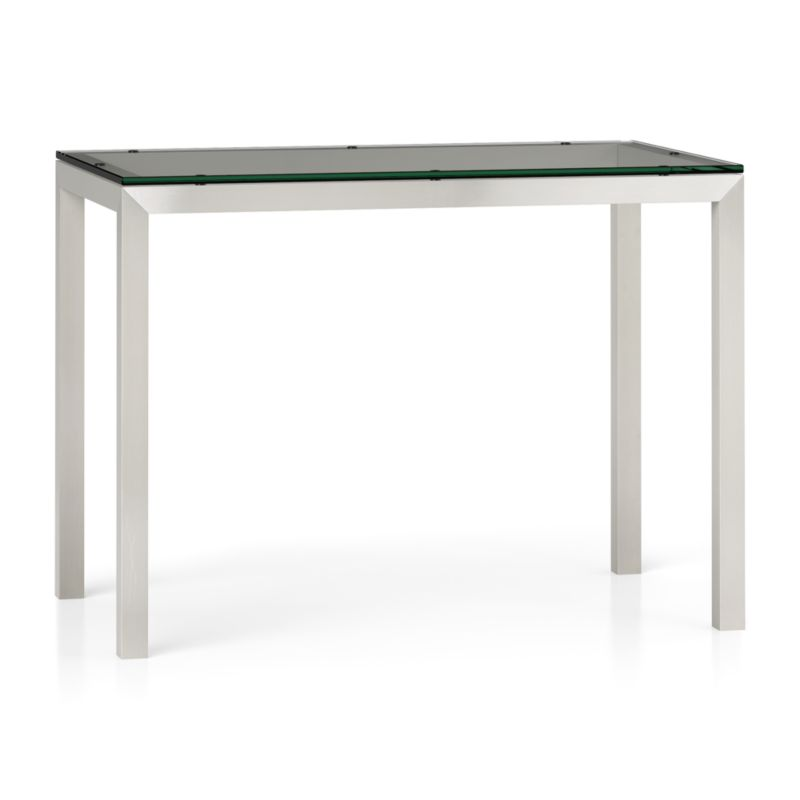 "You've designed your ideal table, from top to bottom in just the right size. Clear float glass makes a transparent top that's ⅝-inch thick with a flat, polished edge. To complement its clean, simple lines, this stainless steel Parsons-style frame gets a soft, contemporary brushed finish that mimics mitered wood corners. Counter-height high dining table seats up to 4. The Clear Glass Top/Parsons Stainless Steel Base 48""x28"" High Dining Table is a Crate and Barrel exclusive.<br /><br /><NEWTAG/><ul><li>⅝"" glass top with flat polished edge</li><li>Non-tempered glass</li><li>Stainless steel base with brushed finish</li><li>Foot caps</li><li>Accommodates counter stools</li><li>Seats 4</li><li>Made in China</li></ul>"