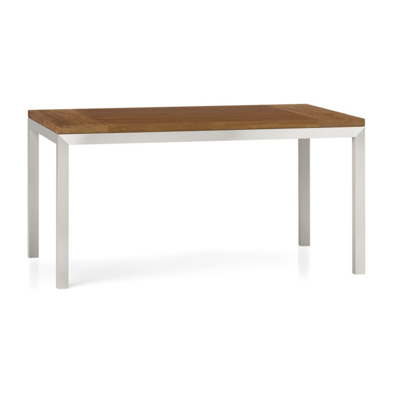 "You've designed your ideal table, from top to bottom in just the right size. This 1 ½""-thick layered wood top is handcrafted from repurposed teak sourced in Southeast Asia, with breadboard construction to allow for seasonal movement.Variations in wood grain, texture and color, knots and other naturally occurring characteristics add to the wood's distinct character. To complement its clean, simple lines, the stainless steel Parsons-style frame gets a soft, contemporary brushed finish that mimics mitered wood corners. Sized to seat up to 6, this table is perfect for everyday dining or entertaining. The Teak Top/Parsons Stainless Steel Base 60""x36"" Dining Table is a Crate and Barrel exclusive.<br /><br /><NEWTAG/><ul><li>Reclaimed, unfinished layered teak tabletop</li><li>Naturally occurring color, texture and knots</li><li>Stainless steel base with brushed finish</li><li>Foot caps</li><li>Seats 6</li><li>Made in China and Indonesia</li></ul>"