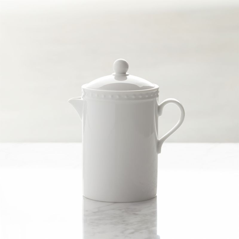Inspired by the decorative influences of early 1900s Vienna, this simply elegant white porcelain creamer features a raised dot pattern around the rim. Excellent quality workmanship makes this a great value. Staccato dinnerware also available.<br /><br /><NEWTAG/><ul><li>Designed by Kathleen Wills</li><li>Dishwasher- and microwave-safe</li><li>Made in Japan</li></ul>