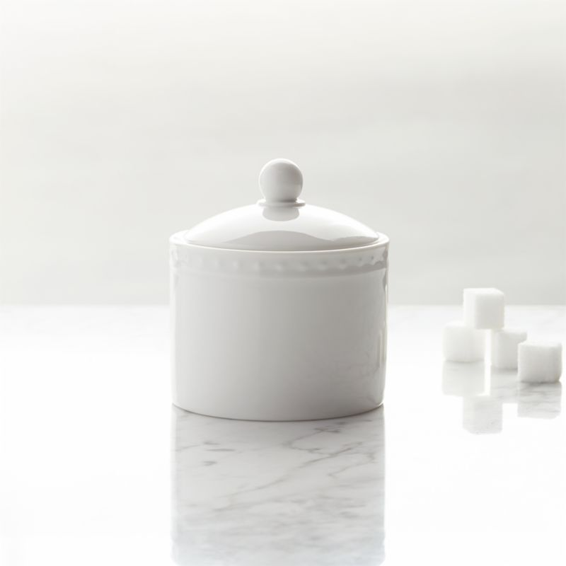 Inspired by the decorative influences of early 1900s Vienna, this simply elegant white porcelain sugar bowl features a raised dot pattern around the rim. Excellent quality workmanship makes this a great value. Staccato dinnerware also available.<br /><br /><NEWTAG/><ul><li>Designed by Kathleen Wills</li><li>Dishwasher- and microwave-safe</li><li>Made in Japan</li></ul>