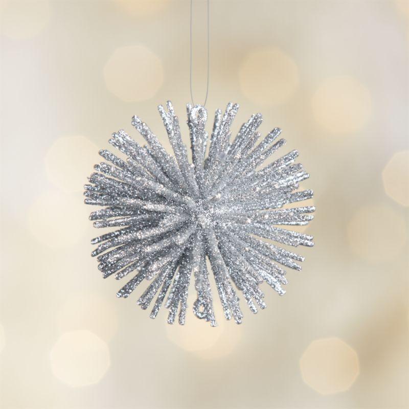 Glittery silver starburst radiates festive spirit as a fun, modern Christmas ornament.<br /><br /><NEWTAG/><ul><li>Plastic and glitter</li><li>Made in China</li></ul><br />