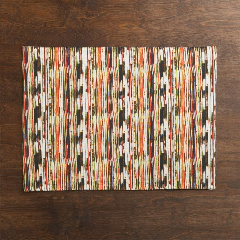 Dynamic lines buzzes contemporary and eclectic in fall hues to mix with a variety of serving pieces. Placemat reverses to solid black.<br /><br /><NEWTAG/><ul><li>Front: 52% linen and 48% cotton</li><li>Back: 100% cotton</li><li>Machine wash cold, dry flat; warm iron as needed</li><li>Made in India</li></ul>