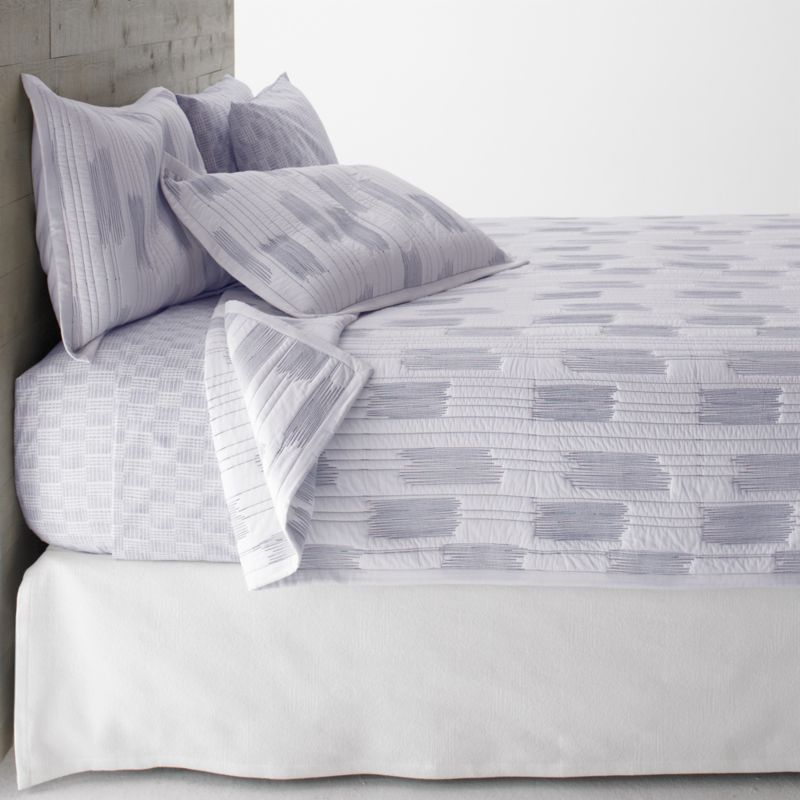 Thin blue line tracks fine lines and occasional zigzag blocks on crisp white cotton for a fresh and contemporary bed. Reverses to self and is cotton-filled, perfect on its own or layered for added warmth.<br /><br /><NEWTAG/><ul><li>100% cotton</li><li>100% cotton fill</li><li>Machine wash, tumble dry low</li></ul><br />