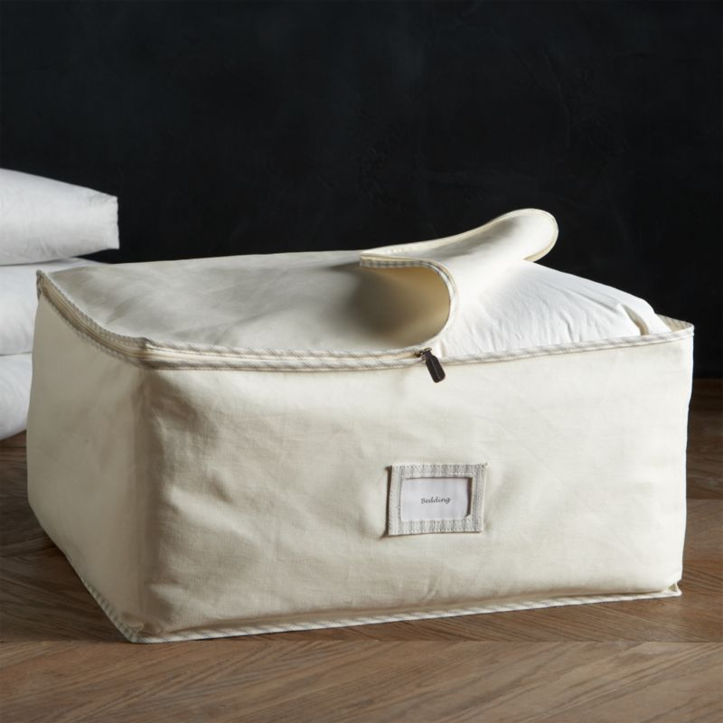 Keep your blankets, linens and other fine garments in pristine condition with our exclusive vintage-inspired storage bag collection. Handmade of all-natural 100% cotton-twill canvas, each bag is exceptionally durable and breathable to protect and preserve the fibers of your clothes and textiles. Trimmed with a classic ticking stripe, this generously sized bag is large enough to store bedding and off-season clothes. A clear window is featured front and center to label and organize your items.<br /><br /><NEWTAG/><ul><li>100% cotton-twill storage bag with cotton-polyester ticking edge</li><li>Polypropylene nameplate window</li><li>Leather zipper pull</li><li>Natural cotton prevents color transfer</li><li>Clean with damp cloth</li><li>Made in China</li></ul>