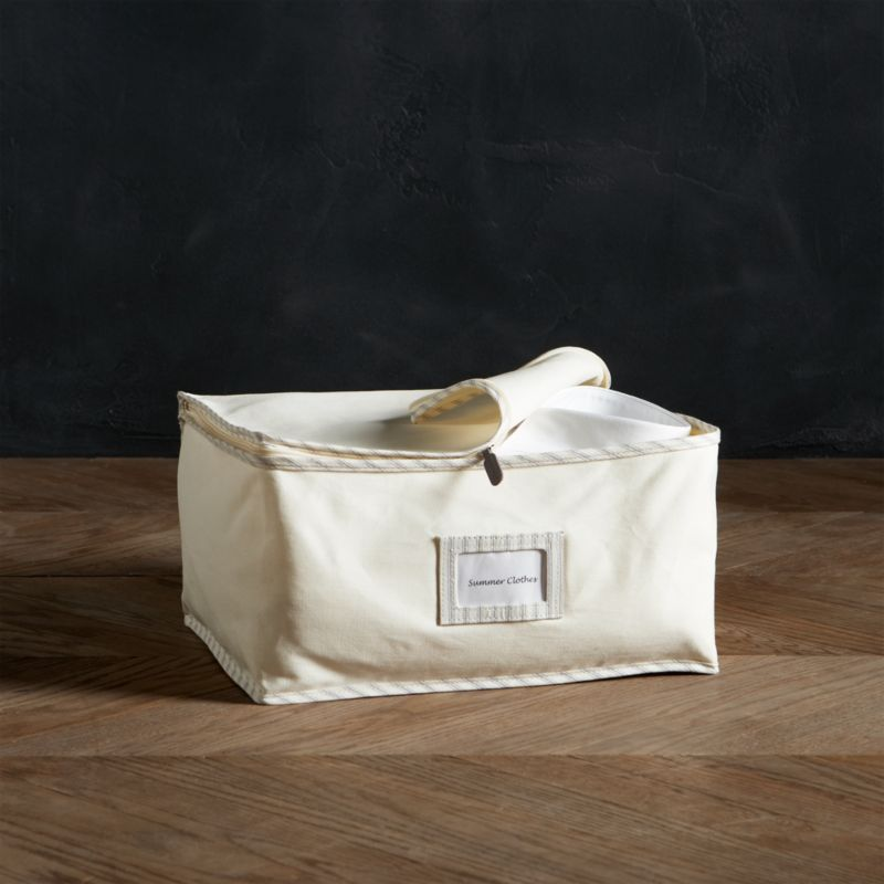 Keep your blankets, linens and other fine garments in pristine condition with our exclusive vintage-inspired storage bag collection. Handmade of all-natural 100% cotton-twill canvas, each bag is exceptionally durable and breathable to protect and preserve the fibers of your clothes and textiles. Trimmed with a classic ticking stripe, this compact bag stores bedding and off-season clothes. A clear window is featured front and center to label and organize your items.<br /><br /><NEWTAG/><ul><li>100% cotton-twill storage bag with cotton-polyester ticking edge</li><li>Polypropylene nameplate window</li><li>Leather zipper pull</li><li>Natural cotton prevents color transfer</li><li>Clean with damp cloth</li></ul>