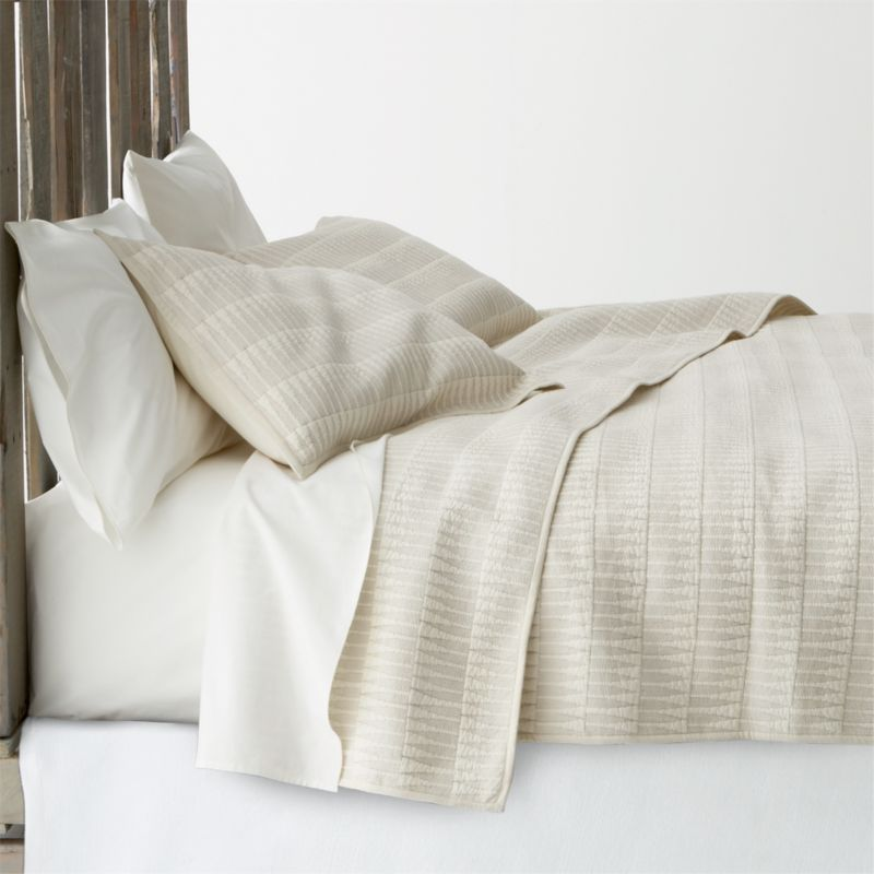 Intricately stitched cream cotton quilt lines up geometric peaks in a modern, graphic grid that looks amazing on its own or paired with our other bedding.<br /><br /><NEWTAG/><ul><li>100% cotton</li><li>100% cotton fill</li><li>Reversible</li><li>Machine wash cold, tumble dry low</li><li>Made in India</li></ul>
