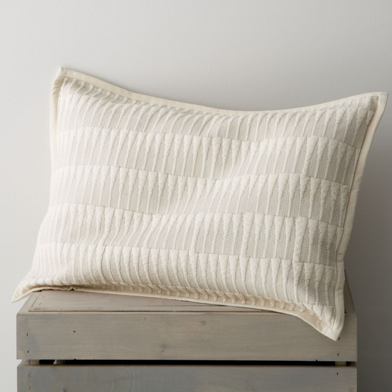 """Intricately stitched cream cotton quilt lines up geometric peaks in a modern, graphic grid that looks amazing on its own or paired with our other bedding. Bed pillows also available.<br /><br /><NEWTAG/><ul><li>100% cotton</li><li>100% cotton fill</li><li>1"""" flange</li><li>Envelope back closure</li><li>Machine wash cold, tumble dry low</li><li>Made in India</li></ul>"""