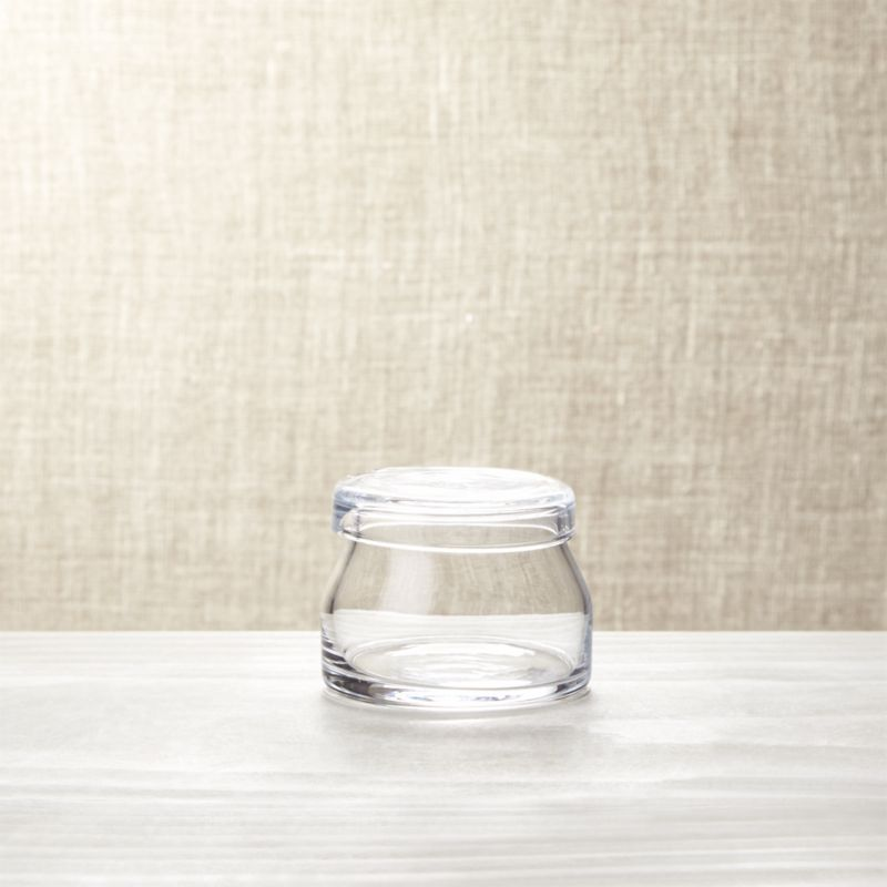 Handcrafted by European artisans with clean lines and flat cap lid, this covered glass sugar bowl shares the retro milk-bottle charm of its creamer counterpart.<br /><br /><NEWTAG/><ul><li>Handmade glass</li><li>Scissor-cut rim</li><li>Hand wash</li><li>Made in Poland</li></ul>