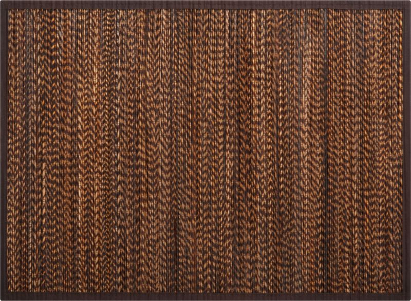 Rustic lidi fiber, taken from the spine of coconut leaves, weaves a beautiful mix of natural browns. Handwoven mats are framed in brown cotton trim.<br /><br /><NEWTAG/><ul><li>Placemat is lidi fiber with 100% cotton trim</li><li>Clean placemat with a dry cloth</li><li>Made in Indonesia</li></ul>