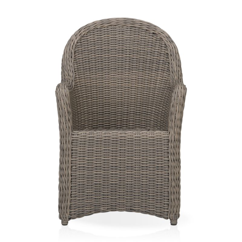 Romantic curves in handwoven resin wicker bring back the nostalgia of garden hospitality. Hand-wrapped around a weather-resistant powdercoated aluminum frame, the Summerlin outdoor dining chair's tonal weathered-grey weave captures the true nature and patina of real cottage wicker. <NEWTAG/><ul><li>Handcrafted</li><li>UV- and weather-resistant resin wicker</li><li>Aluminum frame with powdercoat finish</li><li>Made in Indonesia</li></ul>