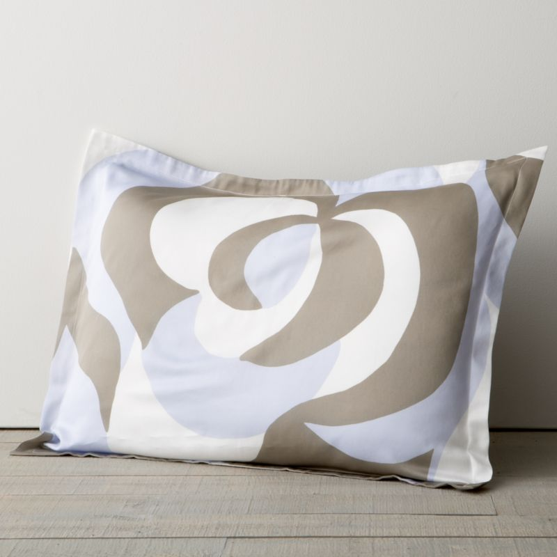 "In its swirling floral forms and dynamic movement, Maija Isola's 1967 design Suudelma (""kiss"") translates the power and passion of human feeling into bold, graphic expression. Sham has 1"" flange and generous overlapping closure. Bed pillows also available.<br /><br /><NEWTAG/><ul><li>100% cotton sateen</li><li>300-thread-count</li><li>Machine wash cold, tumble dry low</li></ul>"