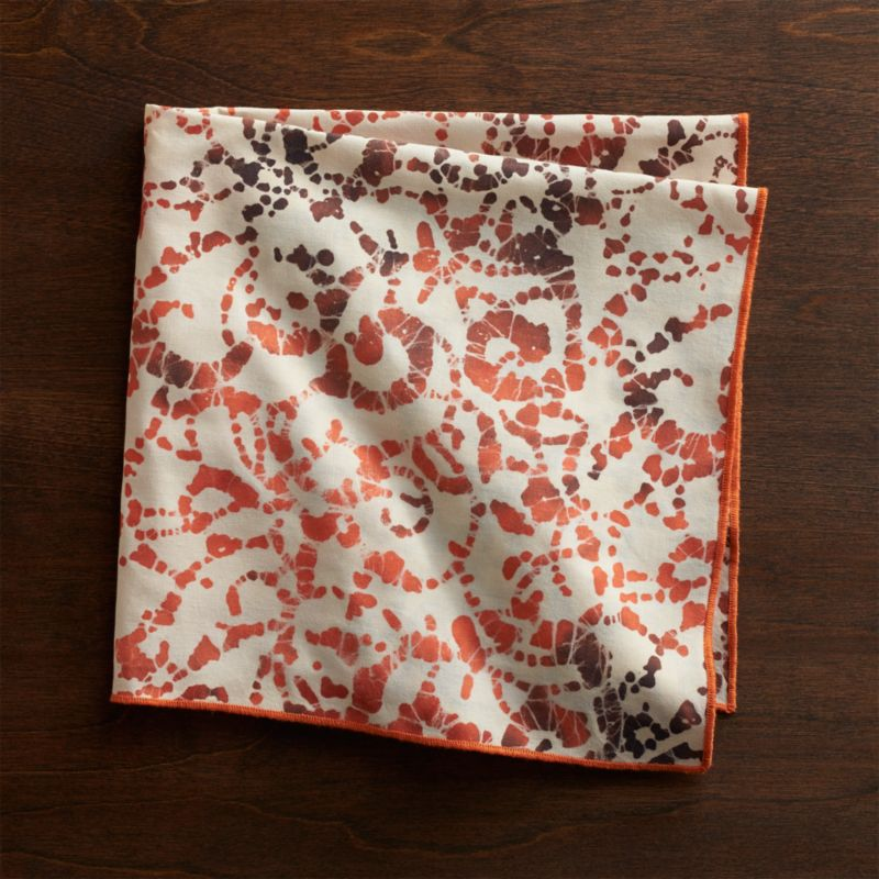 Traditional batik printing spins abstract and expressive swirls in warm fall colors for a contemporary look with artisan appeal. Slight variations to the pattern and color are characteristic of the handcrafted process and make each napkin truly one of a kind.<br /><br /><NEWTAG/><ul><li>Handcrafted</li><li>100% cotton</li><li>Machine wash separately in cold water, tumble dry low; warm iron as needed</li><li>Do not bleach or dry clean</li><li>Made in India</li></ul>