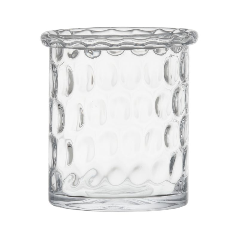 "Textured dimpled design makes an optical show of flickering candlelight. Thick rolled rim is cut and polished by hand for a smooth edge.<br /><br /><NEWTAG/><ul><li>Handmade glass</li><li>Fire-polished rim</li><li>Accommodates a 3""-dia. pillar candle, sold separately</li><li>Wipe clean with damp cloth</li></ul>"