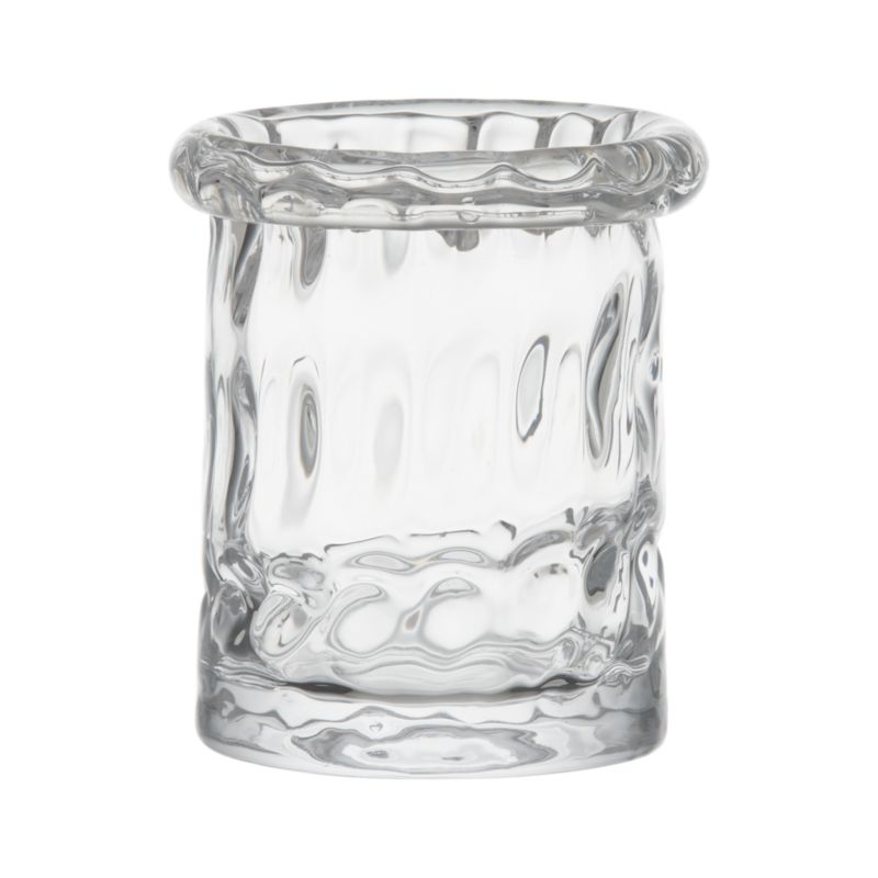 Textured dimpled design makes an optical show of flickering candlelight. Thick rolled rim is cut and polished by hand for a smooth edge.<br /><br /><NEWTAG/><ul><li>Handmade glass</li><li>Fire-polished rim</li><li>Accommodates a standard votive or tealight candle, sold separately</li><li>Wipe clean with damp cloth</li><li>Made in Poland</li></ul>