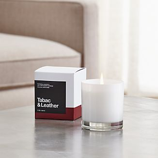 A flicker of fragrance to renew home and spirit. Our exclusive collection of handpoured, soy-blend candles brings together unique scent pairings to express your style and mood. The nuanced sweetness of tobacco and the musky organic character of leather mingle with essences of resin, coriander, white amber, freesia, cashmere wood and vanilla bean.