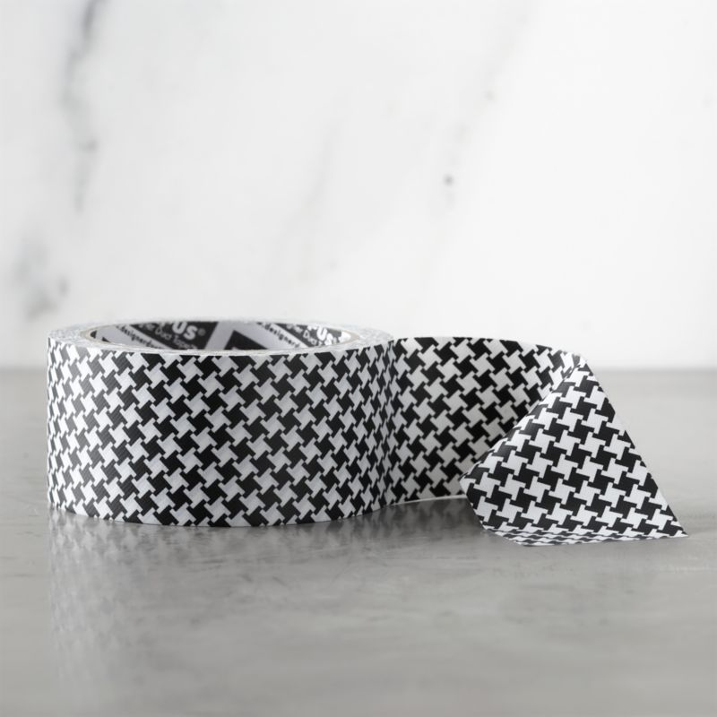 With graphic variations on the classic, the tape becomes part of the packaging or brightens craft projects and repairs. Broad duct tape in black and white houndstooth is crafted to tear by hand, and appears seamless both horizontally and vertically.<br /><br /><NEWTAG/><ul><li>Hot-melt adhesive, plastic film and cotton backing</li><li>Made in China</li></ul>