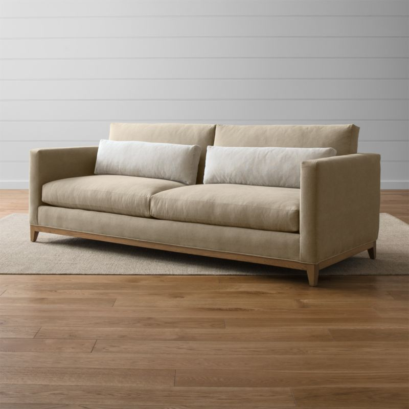 Our Taraval 2-seat sofa relaxes all conventions about what a living room sofa can be. Casual, yet elegant, it's upholstered in all-natural cotton with stonewashed 100% linen kidney cushions lofted with down to hug your lower back in comfort. <NEWTAG/><ul><li>Frame is benchmade with eco-friendly, certified sustainable hardwood that's kiln-dried to prevent warping</li><li>Solid oak legs and base in a weathered grey finish</li><li>Eight-way, hand-tied spring suspension system</li><li>Soy-based polyfoam seat cushions with innerspring coil system, wrapped in polyfiber and feather-down blend and encased in downproof ticking</li><li>Polyfiber and feather-down blend back cushions and kidney pillows encased in downproof ticking</li><li>Includes 2 kidney pillows</li><li>Made in North Carolina, USA of domestic and imported materials</li></ul>