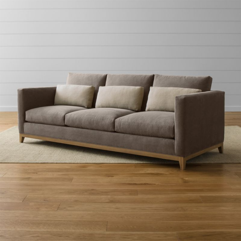 Relaxing all conventions about what a living room sofa can be, our Taraval 3-seat sofa is a casually elegant seating option upholstered in all-natural cotton with an exposed solid oak base in a grey, weathered finish. Stonewashed kidney cushions in 100 percent linen are lofted with down to hug your lower back in comfort. <NEWTAG/><ul><li>Frame is benchmade with certified sustainable hardwood that's kiln-dried to prevent warping</li><li>Solid oak legs and base in a weathered grey finish</li><li>Eight-way, hand-tied spring suspension system</li><li>Soy-based polyfoam seat cushions with innerspring coil system, wrapped in polyfiber and feather-down blend and encased in downproof ticking</li><li>Polyfiber and feather-down blend back cushions and kidney pillows encased in downproof ticking</li><li>Includes 3 kidney pillows</li><li>Made in North Carolina, USA of domestic and imported materials</li></ul><br />