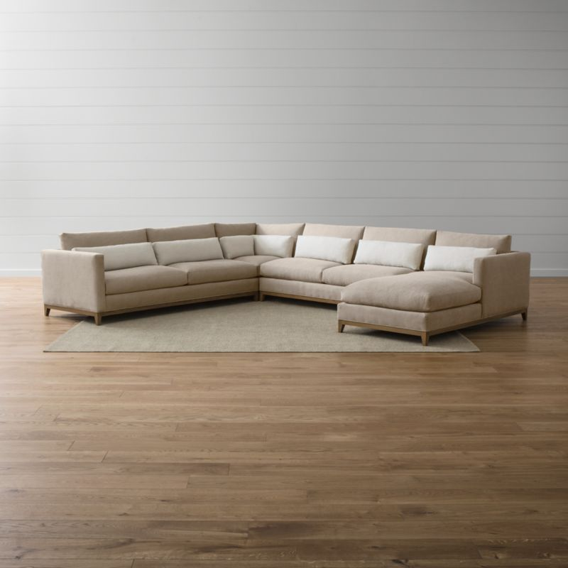 Our Taraval sectional sofa options relax all conventions about living room seating. Casual, yet elegant, the left arm sofa, armless loveseat, right arm chaise and corner—and their many sectional companion pieces—is upholstered in all-natural cotton. Each piece is accented with stonewashed 100% linen kidney cushions lofted with down to hug your lower back in comfort. <NEWTAG/><ul><li>Frames are benchmade with eco-friendly, certified sustainable hardwood that's kiln-dried to prevent warping</li><li>Solid oak legs and bases in a weathered grey finish</li><li>Eight-way, hand-tied spring suspension system</li><li>Soy-based polyfoam seat cushions with innerspring coil system, wrapped in polyfiber and feather-down blend and encased in downproof ticking</li><li>Polyfiber and feather-down blend back cushions and kidney pillows encased in downproof ticking</li><li>Includes 7 kidney pillows</li><li>Made in North Carolina, USA of domestic and imported materials</li></ul>