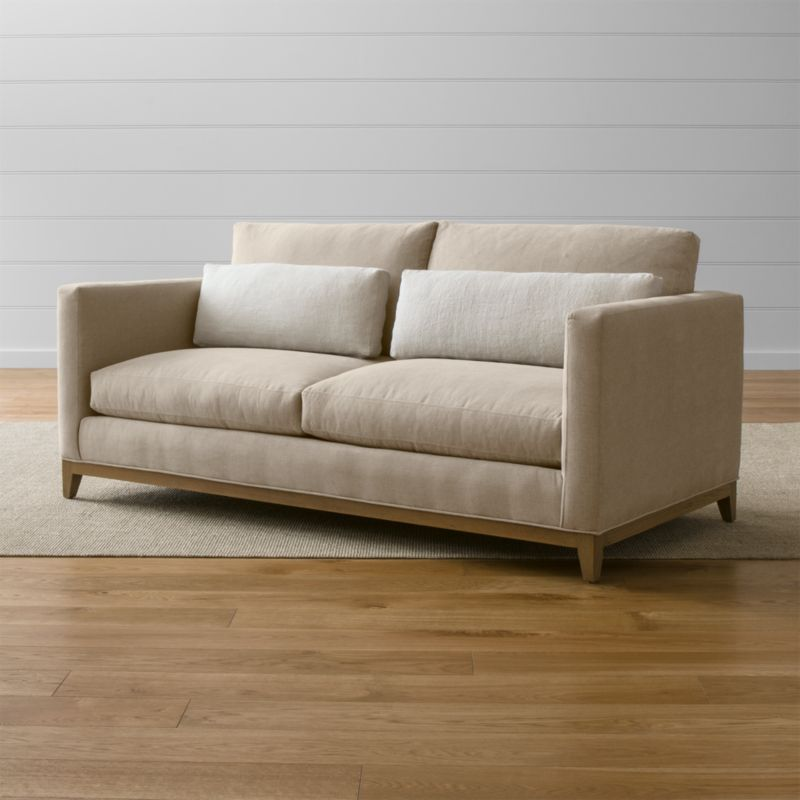 Our Taraval apartment sofa relaxes all conventions about what a living room sofa can be. Casual, yet elegant, it's upholstered in all-natural cotton with stonewashed 100% linen kidney cushions lofted with down to hug your lower back in comfort. <NEWTAG/><ul><li>Frame is benchmade with eco-friendly, certified sustainable hardwood that's kiln-dried to prevent warping</li><li>Solid oak legs and base in a weathered grey finish</li><li>Eight-way, hand-tied spring suspension system</li><li>Soy-based polyfoam seat cushions with innerspring coil system, wrapped in polyfiber and feather-down blend and encased in downproof ticking</li><li>Polyfiber and feather-down blend back cushions and kidney pillows encased in downproof ticking</li><li>Includes 2 kidney pillows</li><li>Material origin: see swatch</li><li>Made in North Carolina, USA of domestic and imported materials</li></ul>
