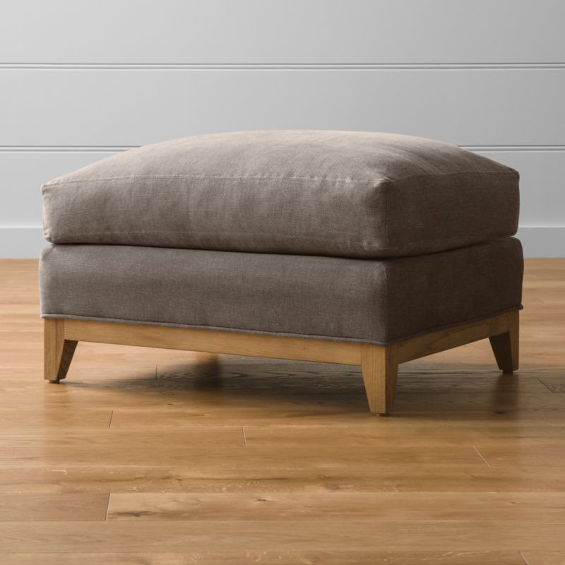 "Our casual yet elegant Taraval 30"" ottoman is upholstered in all-natural cotton with a seat wrapped in extra layers of luxurious down for extra footrest comfort. The exposed solid oak base carries through the relaxed attitude in a grey, weathered finish, the perfect partner to Taraval's multiple stand-alone and sectional options. Taraval 30"" Ottoman with Solid Oak Base is a Crate and Barrel exclusive.<br /><br /><NEWTAG/><ul><li>Frame is benchmade with eco-friendly, certified sustainable hardwood that's kiln-dried to prevent warping</li><li>Solid oak legs and base in a weathered grey finish</li><li>Synthetic web suspension</li><li>Soy-based polyfoam seat cushion with innerspring coil system, wrapped in polyfiber and feather-down blend and encased in downproof ticking</li><li>Made in North Carolina, USA of domestic and imported materials</li></ul>"