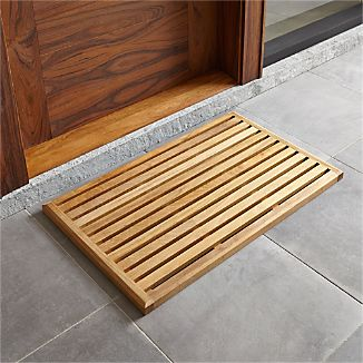 Welcome this beautiful, sustainably forested teak mat for its modern attitude, eco-friendliness, and weather-resistance—then consider that its raised, slatted design diverts moisture and debris. Definitely not slippery when wet.