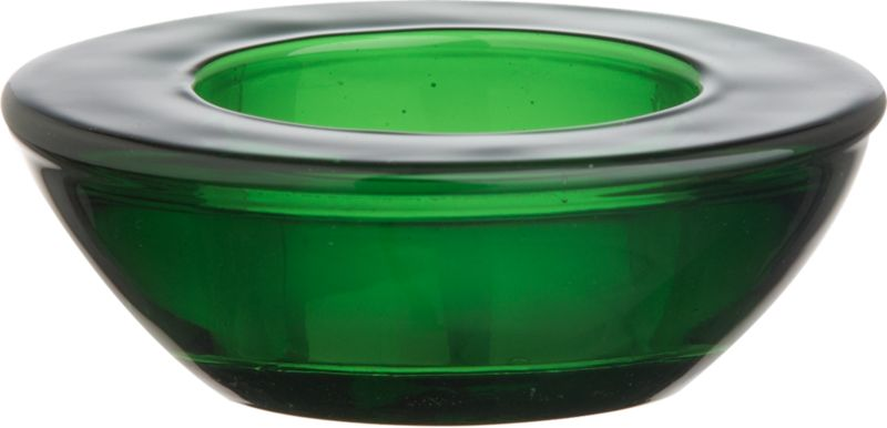 Scatter these substantial, tapered disks of green glass for a sparkling array of candlelight.<br /><br /><NEWTAG/><ul><li>Colored glass</li><li>Accommodates a standard tealight, sold separately</li><li>Clean with a damp or dry cloth</li><li>Made in China</li></ul>