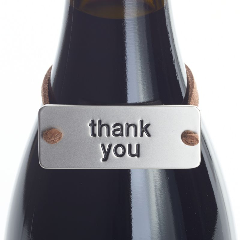 """Neat metal tag on a faux leather cord slips neatly over a gift bottle of wine, embossed to say a simple """"thank you.""""<br /><br /><NEWTAG/><ul><li>Zinc with matte nickel plating</li><li>Faux leather cord</li><li>Clean with damp cloth</li><li>Made in China</li></ul>"""