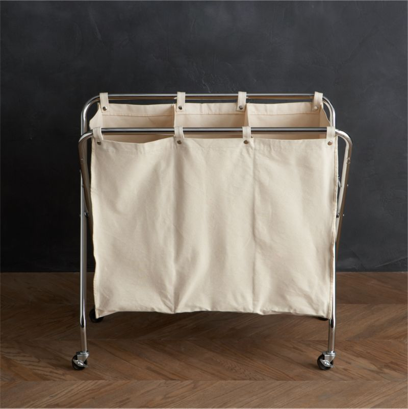 Sort and conquer darks, lights, delicates and towels with this commercial-style sorter in medium-weight cotton canvas. Removable three-section bag affixes to the chrome-plated steel frame with eight stainless snaps. Sorter rolls on rugged industrial casters for convenience, and folds up when laundry day is done.<br /><br /><NEWTAG/><ul><li>Chrome-plated steel frame</li><li>Industrial casters</li><li>100% medium-weight cotton canvas bag</li><li>Stainless steel snaps</li><li>Clean frame with a dry cloth</li><li>Machine wash the removable cotton canvas bag</li><li>Made in Taiwan</li></ul>