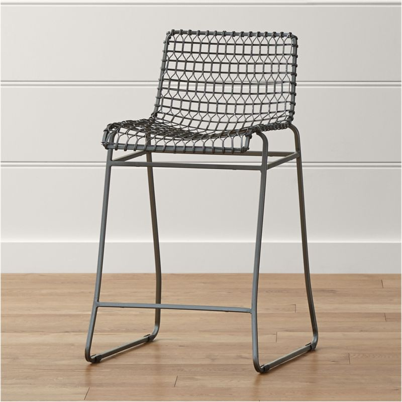 Named for a complex welding technique used to secure non-ferrous metals and copper alloys, our Tig counter stool revels in the contrast of raw metals and the intricate welds that are typically covered with an opaque topcoat. <NEWTAG/><ul><li>Iron rod and tubing with hand-welded brass</li><li>Acid wash bath finish and clear epoxy topcoat</li><li>Plastic feet</li><li>Made in India</li></ul>