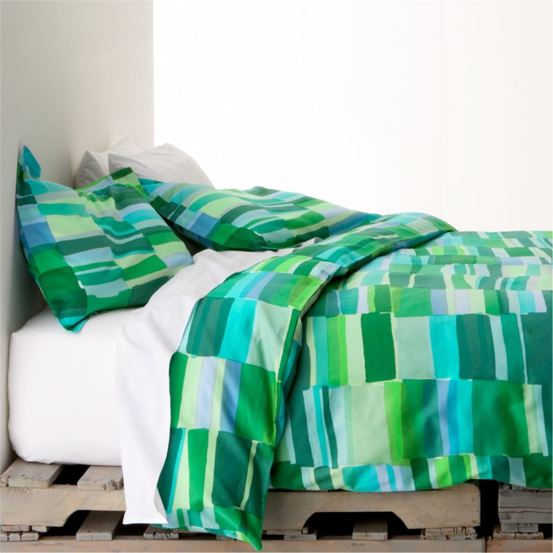"Tilkkula (""scrap"") overlaps artfully irregular rectangles in a sea-inspired palette, designed by Erja Hirvi in 2006.  Ultra-soft 300-thread-count cotton sateen covers are reversible and have hidden-button closures and interior ties to keep duvet insert snugly in place. Duvet inserts also available.<br /><br /><strong>Limited-time offer ends February 20, 2013.</strong><br /><br /><NEWTAG/><ul><li>Pattern designed by Erja Hirvi; 2006</li><li>100% cotton sateen</li><li>300-thread-count</li><li>Machine wash cold, tumble dry</li></ul>"