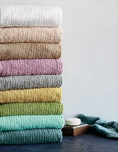 Colorful ribbed bath towels in white, tan, pink, grey, green and blue shades