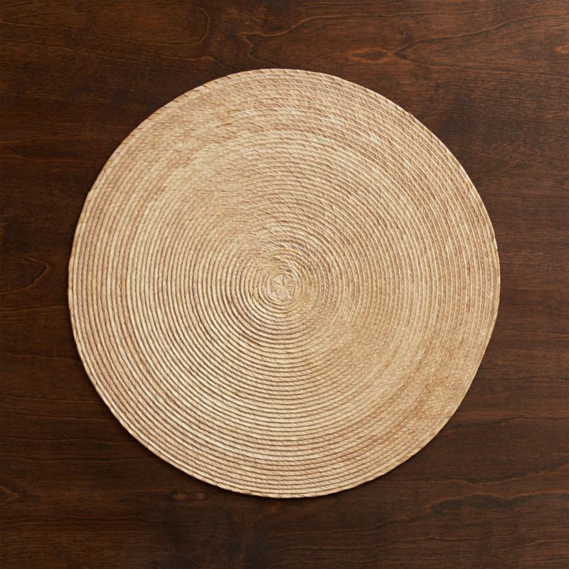 Natural rounds are handmade from natural Mexican palm and sealed with a wax finish for easy cleanup.<br /><br /><NEWTAG/><ul><li>100% palm fiber placemat</li><li>Clean with a damp cloth</li><li>Made in Mexico</li></ul><br />