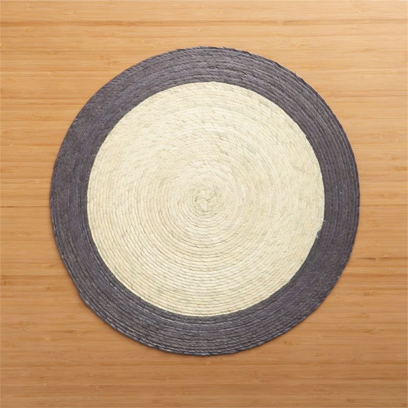 Colorful round with contrasting rimis handmade from natural palm fibers and sealed with a wax finish for easy cleanup.<br /><br /><NEWTAG/><ul><li>98% palm fiber and 2% string</li><li>Wipe clean with damp cloth</li><li>Made in Mexico</li></ul>