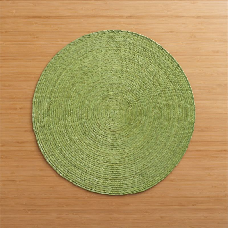 Colorful round is handmade from natural Mexican palm and sealed with a wax finish for easy cleanup.<br /><br /><NEWTAG/><ul><li>100% palm fiber</li><li>Clean with a damp cloth</li></ul>