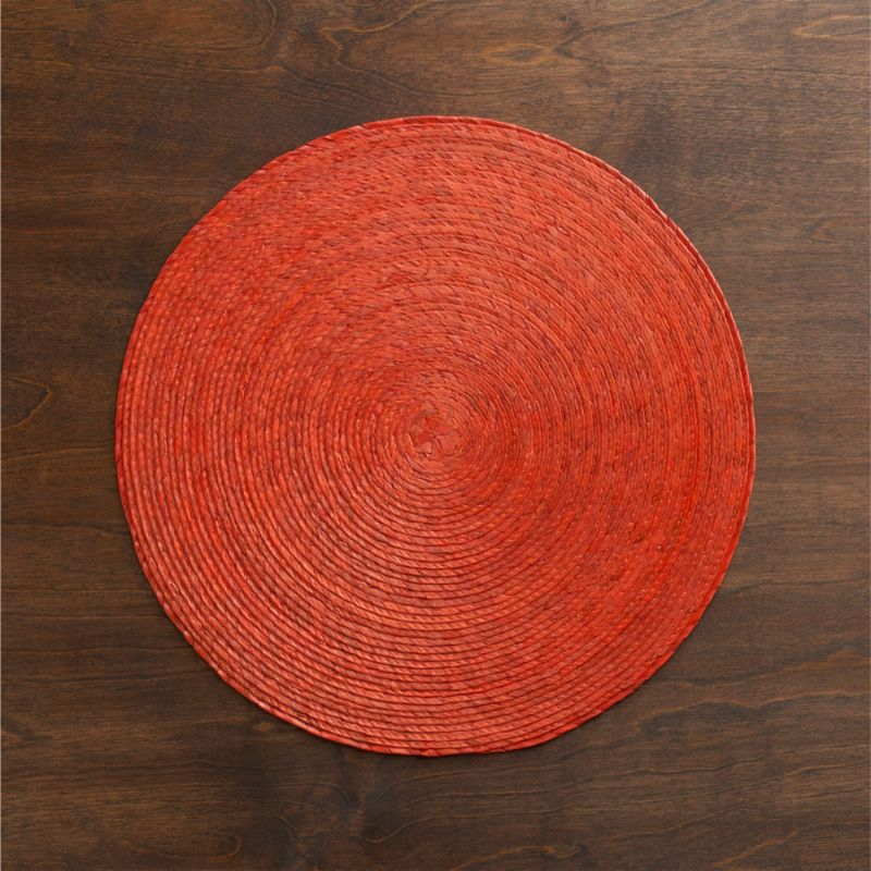 Colorful round is handmade from natural Mexican palm and sealed with a wax finish for easy cleanup.<br /><br /><NEWTAG/><ul><li>100% palm fiber placemat</li><li>Clean placemat with a damp cloth</li><li>Made in Mexico</li></ul>