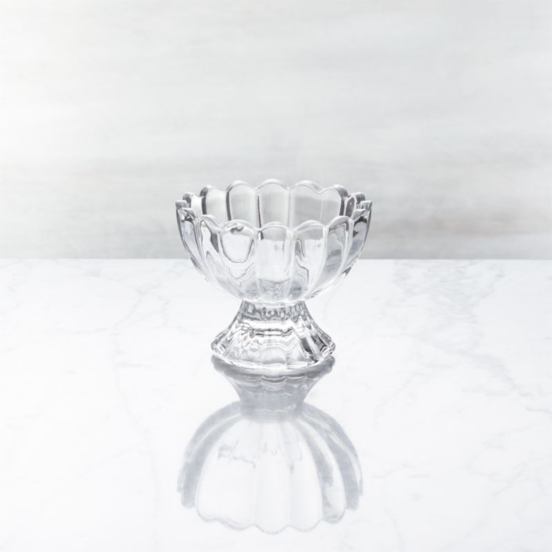 Unabashedly old-time looks put the social in serving ice cream. Everyone's favorite frozen treat gets star treatment in a graceful scalloped dish crafted of molded glass. Also great for candies or nuts.<br /><br /><NEWTAG/><ul><li>Glass</li><li>Dishwasher- and freezer-safe</li><li>Made in China</li></ul>