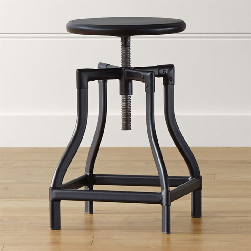 Turner puts a fresh twist on industrial seating with a vintage, architectural look in a clean silhouette. Crafted in sheet and tubular metal enhanced with a black steel finish with faux rivet detailing, the adjustable seat is easily adjustable from counter to bar stool height. The Turner Black Counter-Bar Stool is a Crate and Barrel exclusive.<br /><br /><NEWTAG/><ul><li>Metal sheet and oval tube in black steel finish</li><li>Seat is not removable</li><li>Black plastic floor glides</li><li>Made in The Philippines</li></ul><br />