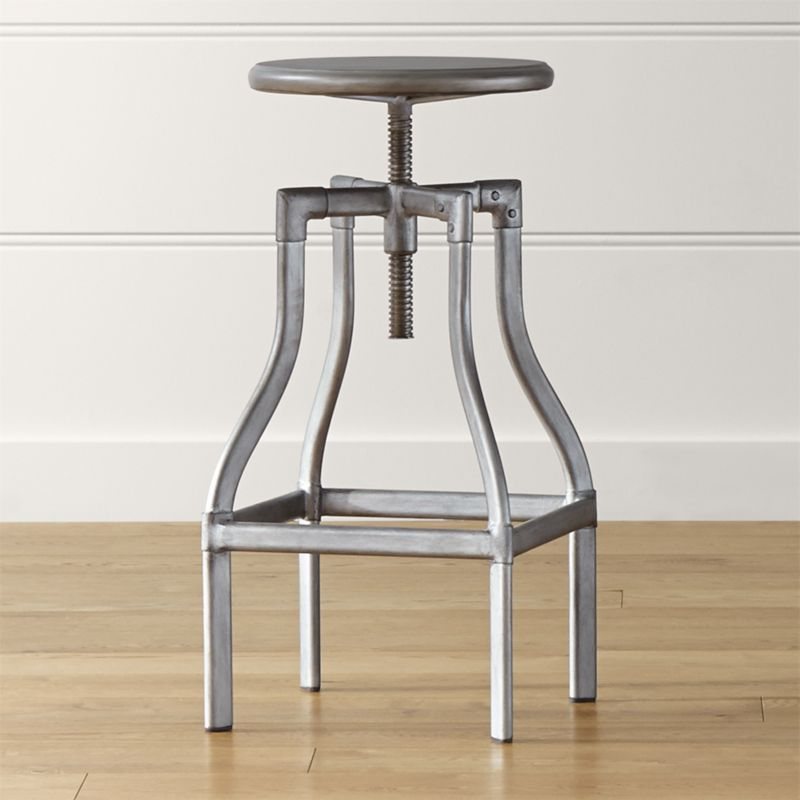 Turner puts a fresh twist on industrial seating with a vintage, architectural look in a clean silhouette. Crafted in sheet and tubular metal enhanced with a gunmetal steel finish with faux rivet detailing, the rotating seat is easily adjustable from counter to bar height. The Turner Gunmetal Counter-Bar Stool is a Crate and Barrel exclusive.<br /><br /><NEWTAG/><ul><li>Metal sheet and oval tube in gunmetal finish</li><li>Seat is not removable</li><li>Black plastic floor glides</li><li>Made in The Philippines</li></ul><br />