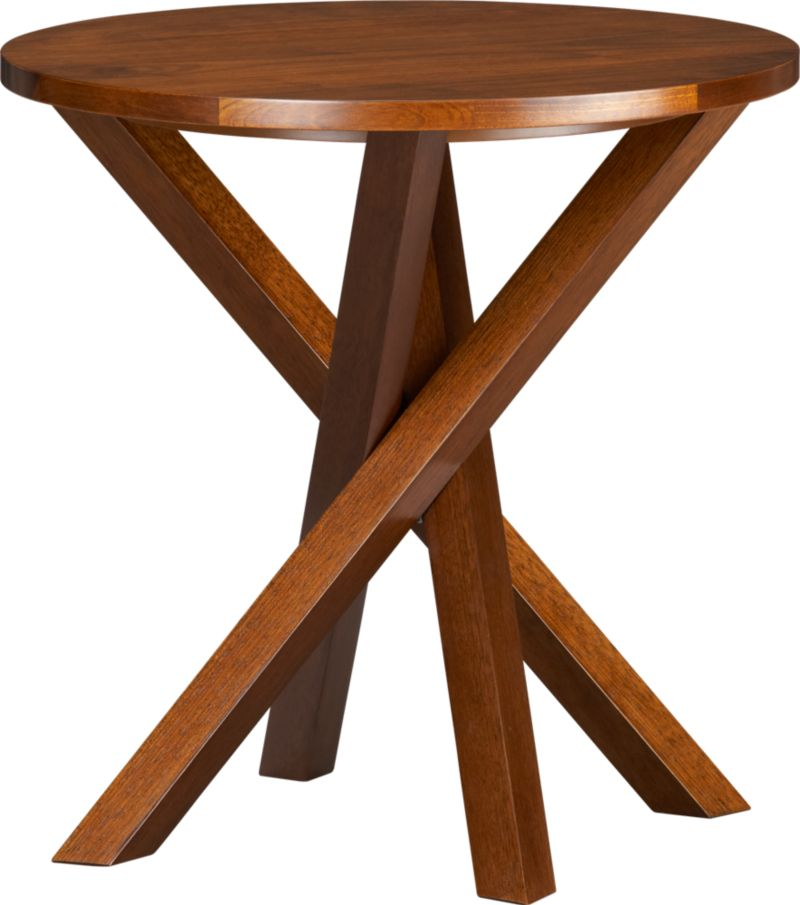 An accent table with an intriguing twist—a dynamic criss-cross base that catches the eye and adds architectural interest to the room. The perfect size and place for drinks, snacks, reading or laptop. Solid wood construction is topped in walnut veneer for a fine hardwood look.<br /><br /><NEWTAG/><ul><li>Solid wood with walnut veneer over low-emission engineered wood</li><li>Clear lacquer finish</li><li>Protective floor glides</li><li>Made in Vietnam</li></ul>
