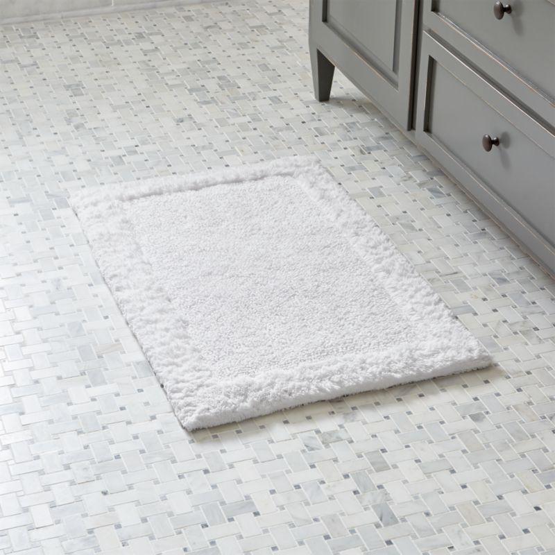Treat your feet to the plush comfort of 100% cotton, looped and sheared to create a super soft and absorbent. Reversible bordered pattern.<br /><br /><NEWTAG/><ul><li>100% cotton</li><li>3,120 grams per square meter</li><li>Machine wash cold, tumble dry low</li><li>Do not iron, bleach or dry clean</li><li>Made in India</li></ul>