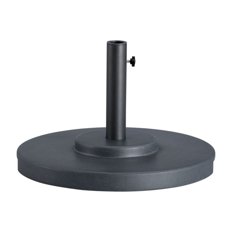 """Scaled-up charcoal grey umbrella stand with rugged construction in carefree rustproof fiberstone anchors your outdoor umbrella, with or without a table. We recommend the large stand for freestanding use.<br /><br /><NEWTAG/><ul><li>Rustproof poly resin and stone mixture in charcoal and black finish</li><li>Cutout handle for easy lifting</li><li>Use large stand with any of our umbrella frames: accommodates 1.5"""" dia. pole with adapter, or 1.875"""" dia. pole without adapter</li><li>Large stand works with a table or on its own</li><li>Assembly required to thread cylinder and feet to base</li><li>Made in China</li></ul>"""