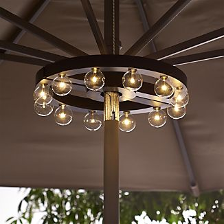 Marquee lights illuminate your outdoor table without extension cords or unsightly clamps. Easy-to-mount design fits snugly around an umbrella pole to cast a glow from on high. Battery-operated unit includes 12 warm-toned LED bulbs that will last approximately 20,000 hours.