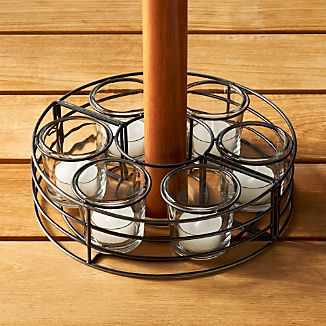 Add flickering candlelight to your outdoor gather with this unique tea light centerpiece. An open metal frame with six glass cups for tea lights latches around a standard outdoor umbrella pole. Suitable for real or flameless tea lights.
