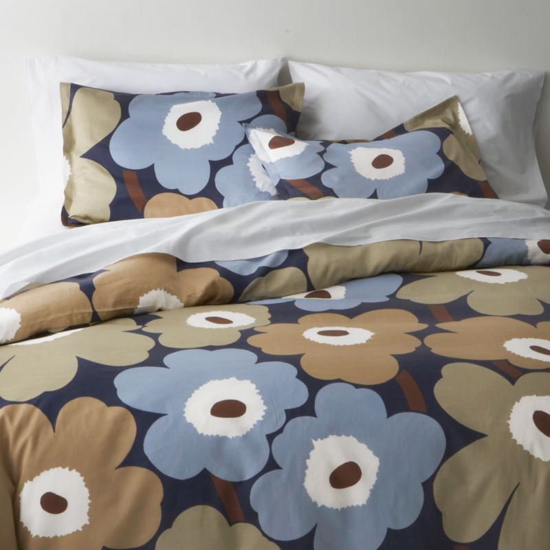"Designed in 1964 by Maija Isola, the Unikko (""poppy"") design has been the most popular Marimekko print since its introduction. Challenging the common notion of decorative florals, Unikko broke from tradition with its creative pop art interpretation in bold, simplified pattern and bright color. Reproduced in infinite color combinations over its 47-year history, the pattern remains current while symbolizing the free spirit of its designer and those who admire it. Duvet cover reverses to self, with hidden button closure at bottom and interior fabric ties to hold the insert in place. Duvet inserts also available.<br /><br /><NEWTAG/><ul><li>Pattern designed by Maija Isola; 1964</li><li>100% cotton sateen</li><li>300-thread-count</li><li>Machine wash cold</li><li>Made in Pakistan</li></ul>"