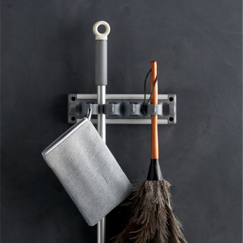 """We've partnered with the """"beautiful house"""" experts at Casabella® to bring you our exclusive curated line of household cleaning essentials. For the smartest utility storage, this ingeniously designed gripper in our exclusive grey holds up to seven cleaning tools, cloths, garden implements and more in a minimum of space. Soft rubber grips hold items securely while allowing easy placement and removal.<br /><br />Casabella® was founded in 1988 when Bruce Kaminstein discovered a unique mop in Italy, which inspired his vision for expertly crafted, custom utility designs that are as beautiful as the homes they clean.<br /><br /><NEWTAG/><ul><li>Designed exclusively for Clean Slate™ by Casabella®</li><li>Crafted of nylon, polypropylene, steel and aluminum</li><li>Holds up to seven items</li><li>Clean with a damp cloth</li><li>Made in China</li></ul>"""