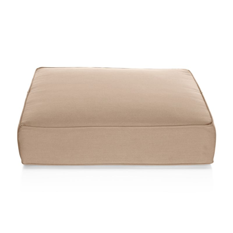 Thick cushion in fade- and mildew-resistant Sunbrella acrylic adds plush comfort to our Ventura ottoman. The Ventura Outdoor Sunbrella Ottoman Cushion is a Crate and Barrel exclusive.<br /><br /><NEWTAG/><ul><li>Fade- and mildew-resistant Sunbrella acrylic</li><li>Foam fill</li><li>Made in USA</li></ul>