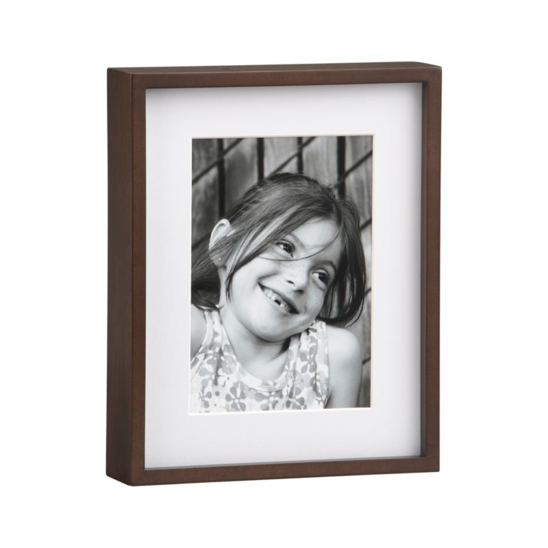 Contemporary walnut frame stands up at a 90-degree angle without an easel. Displays either horizontal or vertical photos.<br /><br /><NEWTAG/><ul><li>Low-emission engineered wood and walnut veneer, glass, paper</li><li>Matte finish</li><li>Clean with dry cloth</li><li>Made in China</li></ul>